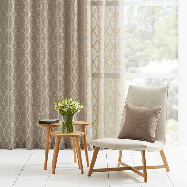 How to use sheer curtains to complete a room
